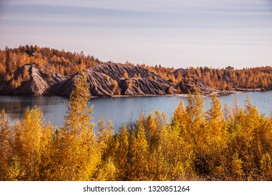 Russia. Tula region. Village Konduki. Unusual natural landscape. Mountains. Blue Lake. Bright autumn colors. Lots of trees in yellow-orange outfit. Morning. A lot of sun. - Shutterstock ID 1320851264