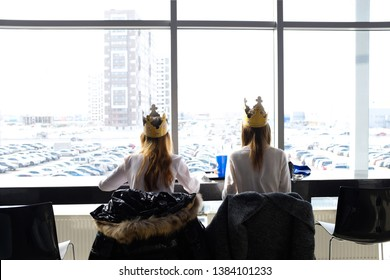 Russia, Tyumen, 03.09.2019. Teenage girls in crowns Burger king having lunch at the Mall. girls have lunch at the Mall