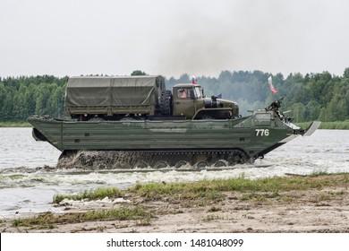 "Russia. Tyumen, August 10, 2019: International Army Games. Final ""Engineering formula"" Floating Transporter PTS-2, polygon route, andreevskoye lake, cargo truck crossing Ural-4320"