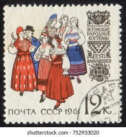 RUSSIA, USSR - CIRCA 1961: A stamp printed in USSR (Soviet Union), shows Regional Folk Costumes. Estonian Folk Costumes, circa 1961
