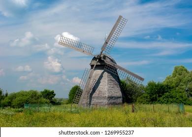 Russia, Veliky Novgorod 01,04,2012 Wooden windmill (XIX century) near Polnoe Konobeevo village, summer landscape