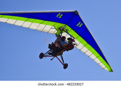 Russia, Veselovka - September 6, 2016: Trike, flying in the sky with two people. Extreme Entertainment travelers.
