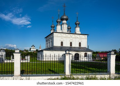 Russia, Vladimir Oblast, Golden Ring, Suzdal: Panorama view of famous Peter and Paul church next to Intercession Convent with blue sky in the city center of one of the oldest Russian towns - religion