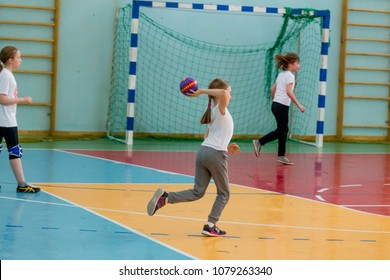 Russia, Vladivostok, 04/28/2018. Kids indoors training before handball competition. Sports and physical activity. Training and sports for children.