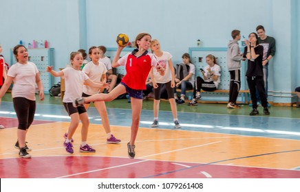 Russia, Vladivostok, 04/28/2018. Kids play handball indoor. Sports and physical activity. Training and sports for children.
