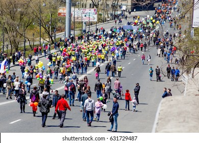 Russia, Vladivostok. 05/01/2017. A lot of people walk along the street in the spring and labor festival on May'01. Holidays and vacations.