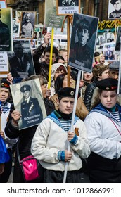 Russia, Vladivostok, 05/09/2015. People hold portraits of their relatives, participants of Great Patriotic War between USSR and Nazi Germany. Immortal Regiment event on annual Victory Day on May'9.