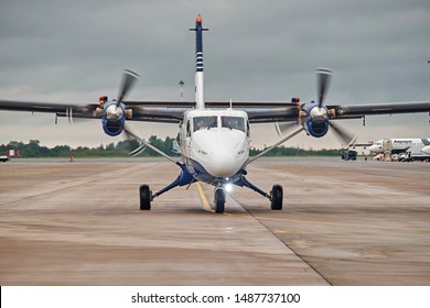 Russia, Vladivostok, 08/21/2019. Passenger plane DHC-6-400 of Aurora Airlines on runway, front view. Turboprop engine. Aviation and transportation.
