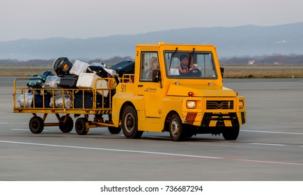 Russia, Vladivostok, 10/13/2017. Autocar with luggage of passengers in airport. Such cars are used to transport luggage to plane and vice versa. Transportation and equipment of airport.