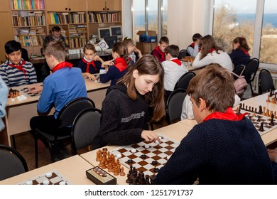 Russia, Vladivostok, 12/01/2018. Kids play chess during chess competition in chess club. Education, chess and mind games. Competition and tournament. Kids' leisure.