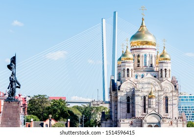 Russia, Vladivostok. Downtown of Vladivostok with the most famous sights of city (Savior Transfiguration Cathedral, Golden Bridge and Memorial to the Fighters for the Soviet Power).