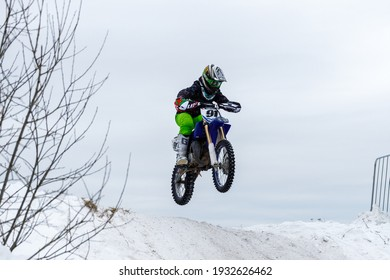 Russia Vyborg 02.23.2021 A man on a sports motorcycle in winter rides down the mountain. High quality photo