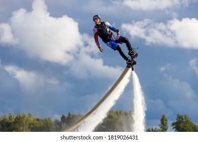 Russia. Vyborg. 05.09.2020. A man flies on a FlyBoard. on the shore of the lake.