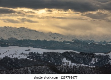 Russia. Winter views of the snowy mountains of the Caucasus. Formation and movement of clouds over mountains peaks.