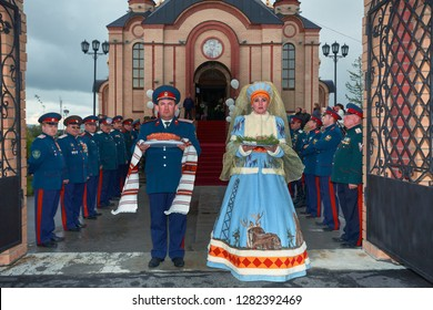 Russia, Yamal, Tarko-Sale - July 2011: Portrait of group of cossacks in traditional uniform. Cossacks is traditional paramilitary community.