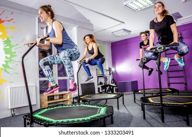RUSSIA, YAROSLAVL - 16 DEC. 2018: a group of happy women warming up before training in the gym jumping on the trampoline