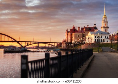 Russia, Yaroslavl region, the city of Rybinsk. The embankment of the Volga River and the building of the Rybinsk reserve museum at sunset. The Transfiguration Cathedral. City landscape