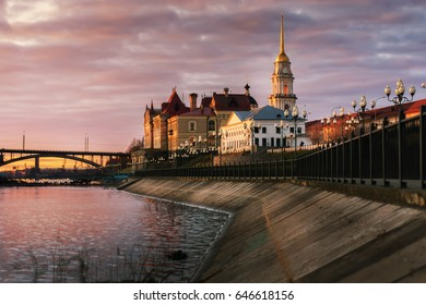 Russia, Yaroslavl region, the city of Rybinsk. The embankment of the Volga River and the building of the Rybinsk reserve museum at sunset. The Transfiguration Cathedral City landscape