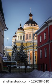 Russia, Yaroslavl region, Rybinsk. City street in winter with houses, road and cathedral