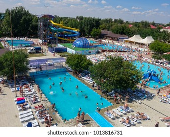 RUSSIA, YAROVOE LAKE, JULY 21: 2017: People relax, bathe in the outdoor pool in sunny day, Yarovoe lake, Russia, July 21, 2017
