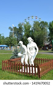 RUSSIA-KEMEROVO 2015: Park of Miracles.Plaster boy and girl playing ball. Sculpture from the Soviet past.