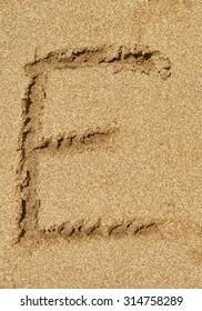 Russian alphabet written in sand