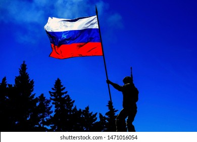 Russian army soldier with a flag. Military conceptual view.
