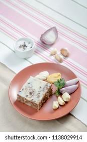 Russian aspic - kholodets with chopped horseradish (khren), garlic, onion and mustard