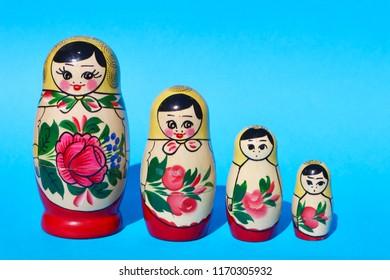 Russian Babushka Nesting Dolls on Blue Background