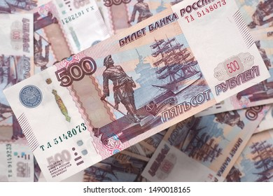 Russian banknote of five hundred rubles hanging over the field of the same banknotes. The view from the top. Close up