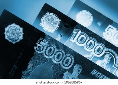 Russian banknotes 5000, 1000, and 500 rubles close up. Dark dramatic black and blue illustration about economy and money of Russia. Inverting. Macro - Shutterstock ID 1962885967