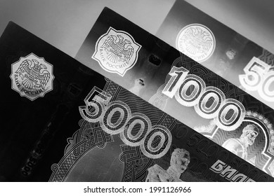 Russian banknotes 5000, 1000 and 500 rubles close-up. Dark black and white illustration about economy, money and finance of Russia. The picture looks like an engraving. Macro - Shutterstock ID 1991126966