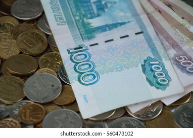 russian banknotes on coins background