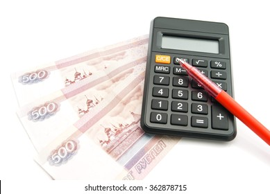 Russian banknotes, red pen and calculator on white