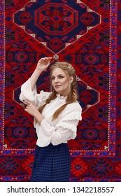 Russian beautiful girl at winter countryside
