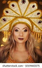 Russian Beauty. Attractive female wearing in kokoshnik. Womans headdress in old Russia