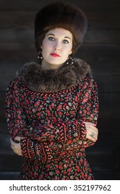 Russian beauty in traditional medieval style clothing with crossed arms portrait