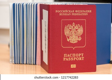 Russian biometric passport against other documents during border control. Inscription - Russian Federation. Passport. Close-up