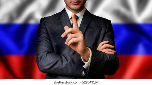 Russian candidate speaks to the people crowd with one finger on lips - election in Russia