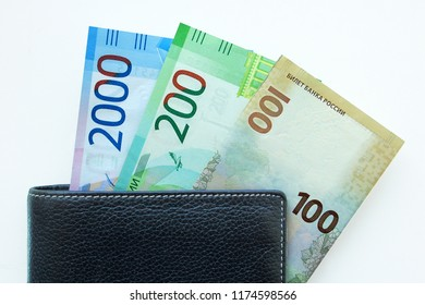 Russian cash. Bill in 2000 and 200 rubles. Black man's purse. Isolated on white