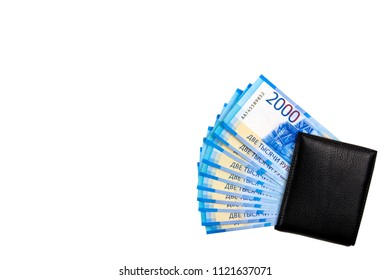 Russian cash. Bill in 2000 rubles. Black man's purse. Isolated