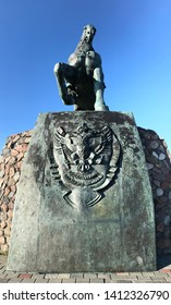 Russian city Baltijsk in Kaliningrad .Monument to Russian queen Ekaterina on horse and two headed eagle national blazon.
