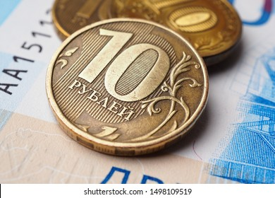 Russian coins of 10 rubles are on a Russian banknote of 2000 rubles. Close-up