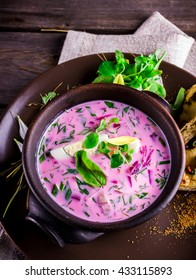 Russian cold soup with beetroot on dark wooden table. Style rustic. Selective focus.
