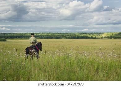 Russian Cossack uniformed WWI inspecting the border on horseback
