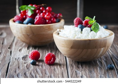 Russian cottage cheese with berry and mint, selective focus