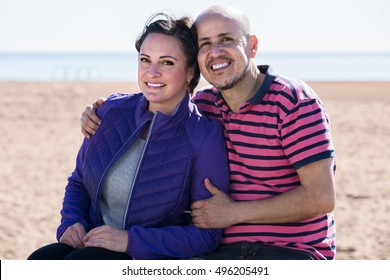 russian couple smiling holding each other on the beach