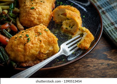 Russian cuisine stuffed chicken cutlets kiev-style with butter sauce