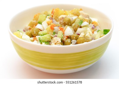 Russian dish called winter salad. Healthy food in a bowl isolated on white.