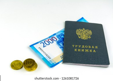 Russian documents. Work book,employment record, a document to record work experience. Russian cash, banknotes 2000 rubles and several coins. On white